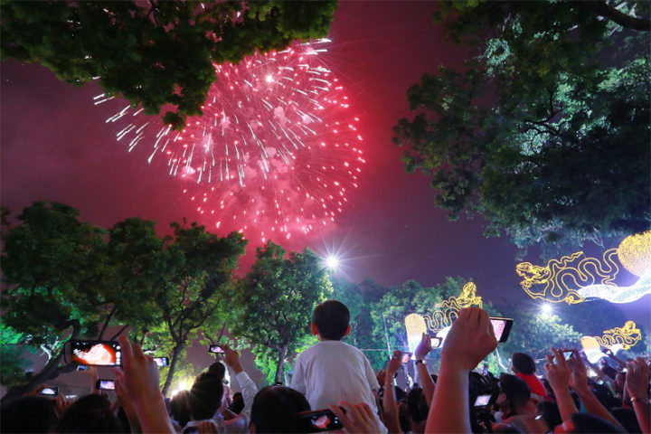 People go out to see fireworks in New Year's Eve