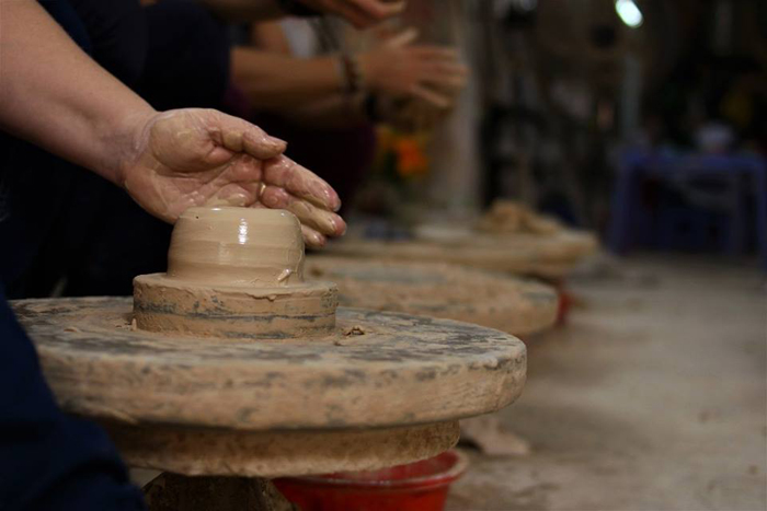 Daily work at Bat Trang ceramic village
